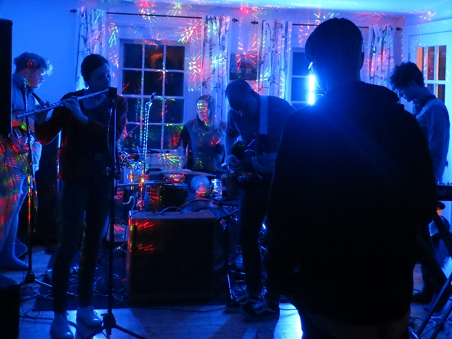 The band Moon playing in a living room in Mineville, Nova Scotia in 2013